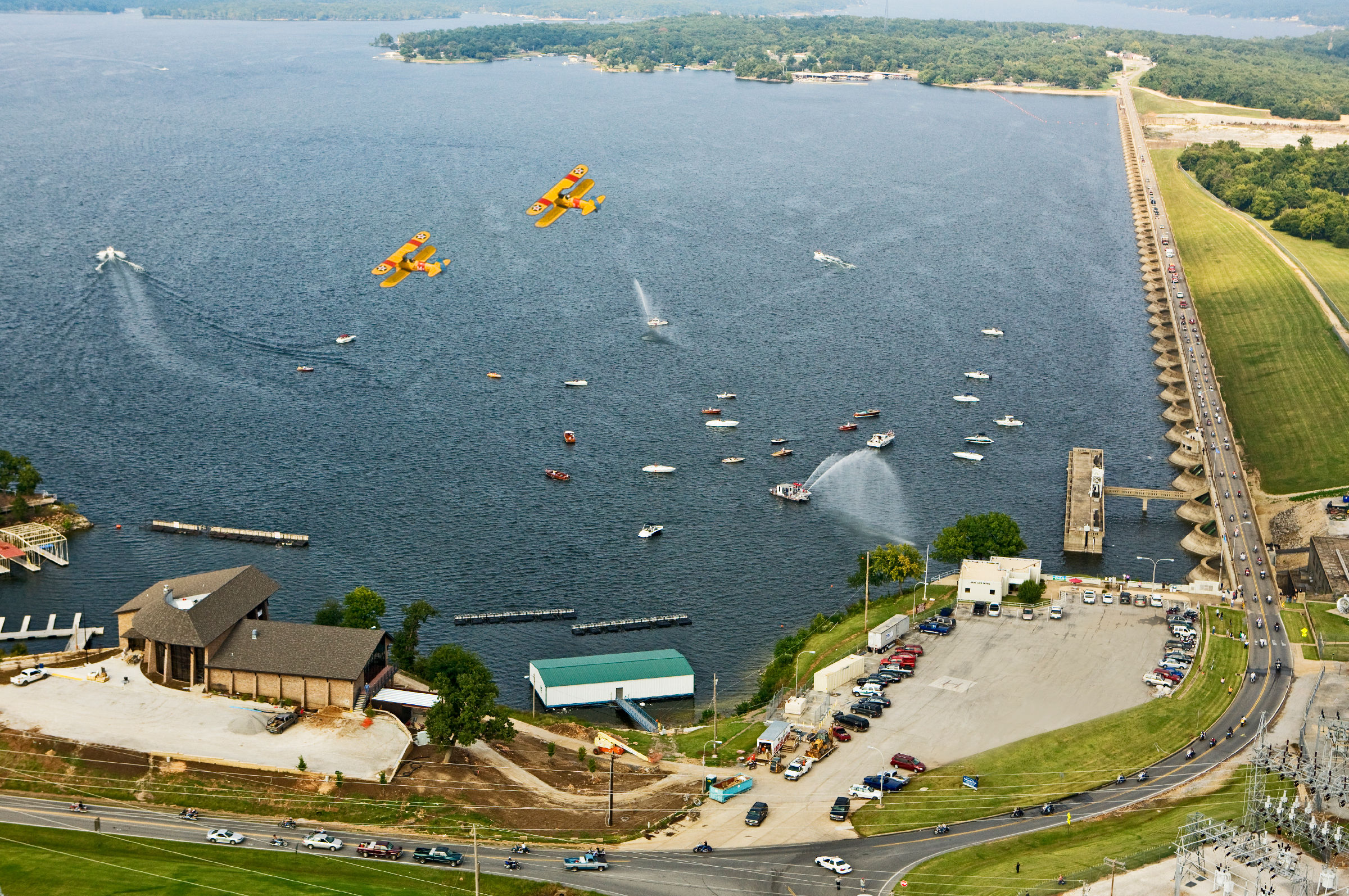 Grand lake dam with biplanes and motorcycles
